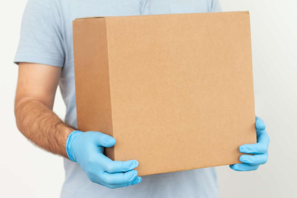 photo of a man holding a box - real estate law toronto