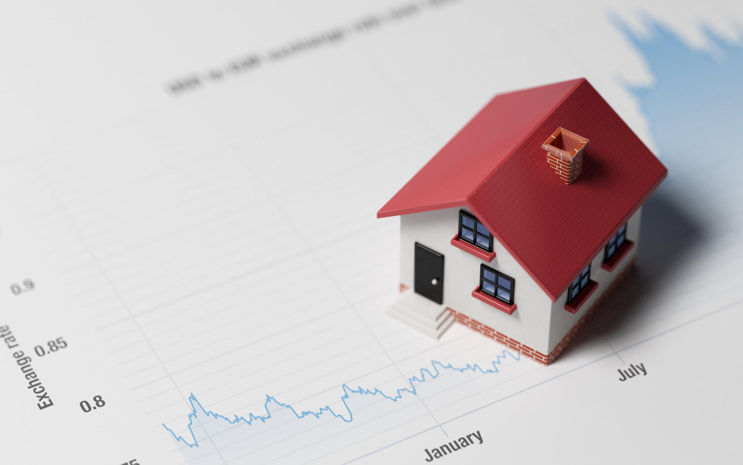 photo of toy house and mortgage graph - mortgage lawyer